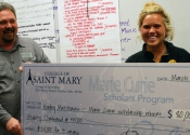 Hayley Matthews of Glenwood, Iowa, accepts the $80,000 Marie Curie Scholarhip to College of Saint Mary.